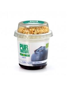 Yogur ecológico con una base de Arándanos en un envase de 150g. y una capa superior de 10g. de Muesli.